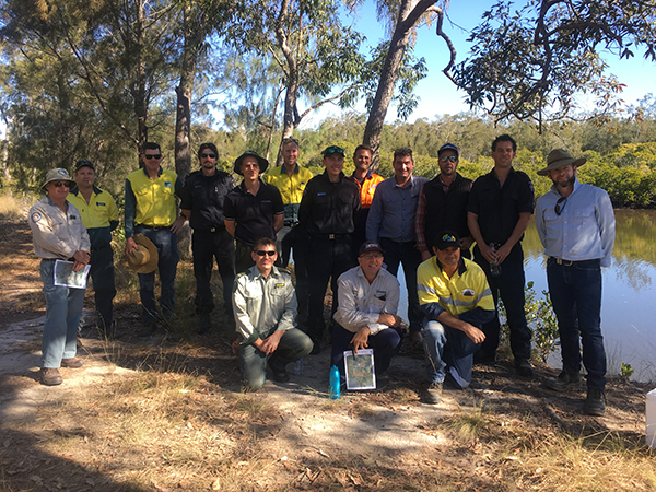 Prescribed burning practitioners near fishing hole in queensland